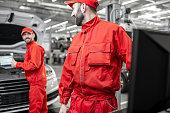 istock Auto mechanics doing diagnostics with laptop 1081595036