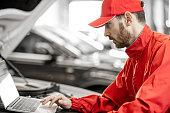 istock Auto mechanics doing diagnostics with laptop 1081595242