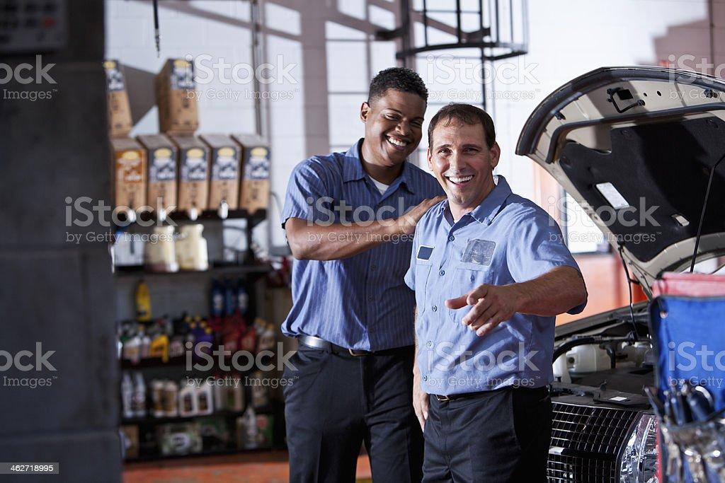 Auto mechanics in garage stock photo