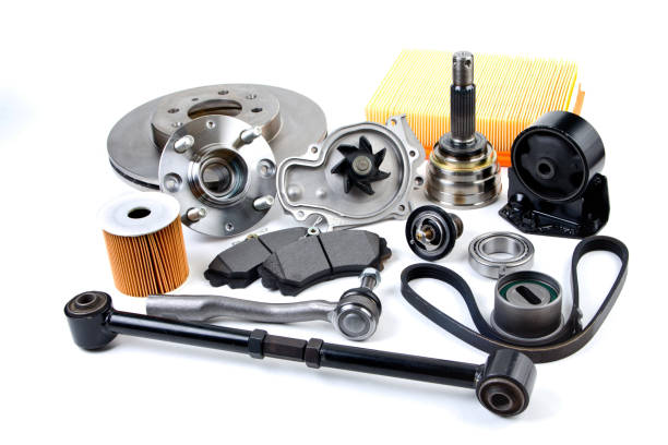 Auto parts background. Hub, pump, brake pads, filter, timing belt, rollers, constant velocity joints, thermostat and other on white background. Set of spare parts for repair stock photo