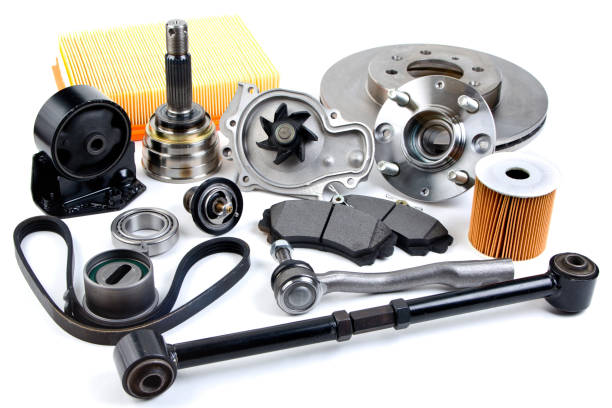 Auto parts background. Hub, pump, brake pads, filter, timing belt, rollers, constant velocity joints, thermostat and other on white background. Set of spare parts for repair Auto parts background. Hub, pump, brake pads, filter, timing belt, rollers, constant velocity joints, thermostat and other on white background. Set of spare parts for repair vehicle part stock pictures, royalty-free photos & images