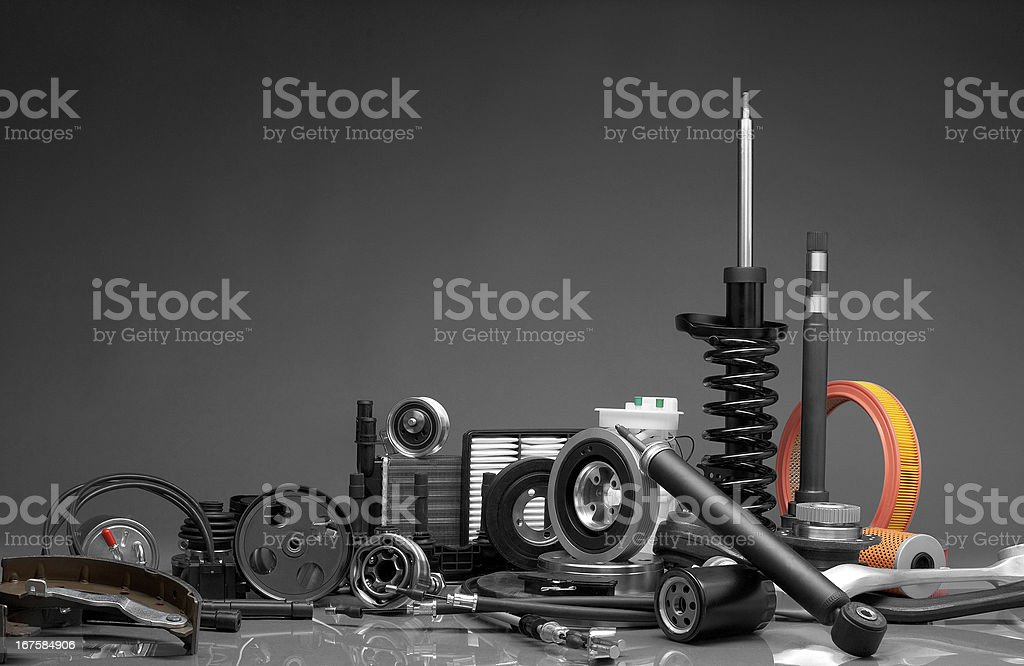Auto parts in a pile with gray background stock photo