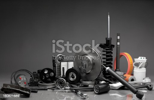 New car parts on a gray background