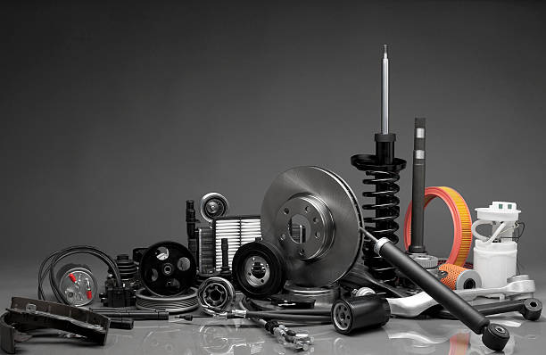 Auto parts New car parts on a gray background vehicle part stock pictures, royalty-free photos & images