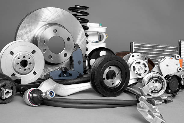 Auto parts New car parts on a gray background closeup vehicle part stock pictures, royalty-free photos & images