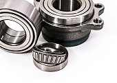 istock Auto parts. Spare parrts for the rapair of cars. Car parts. Bearings on a white background isolated. 1191464576