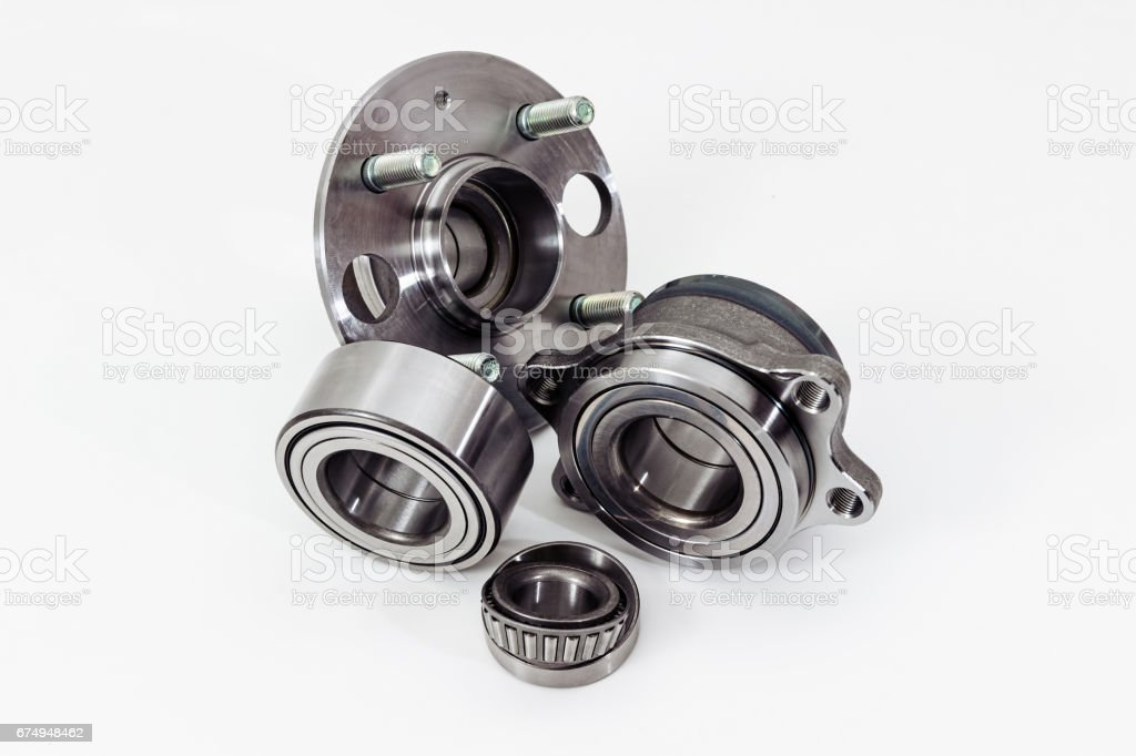 Auto Parts. Spare parts for the repair of cars. Bearings on a white...