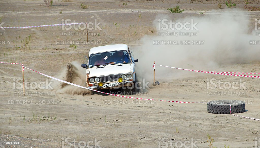Auto racing trial in the sand pit. Four-wheel drive car jumps over...