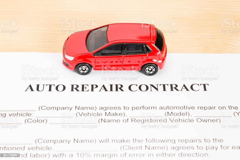 Auto Repair Contract With Red Car on Center stock photo