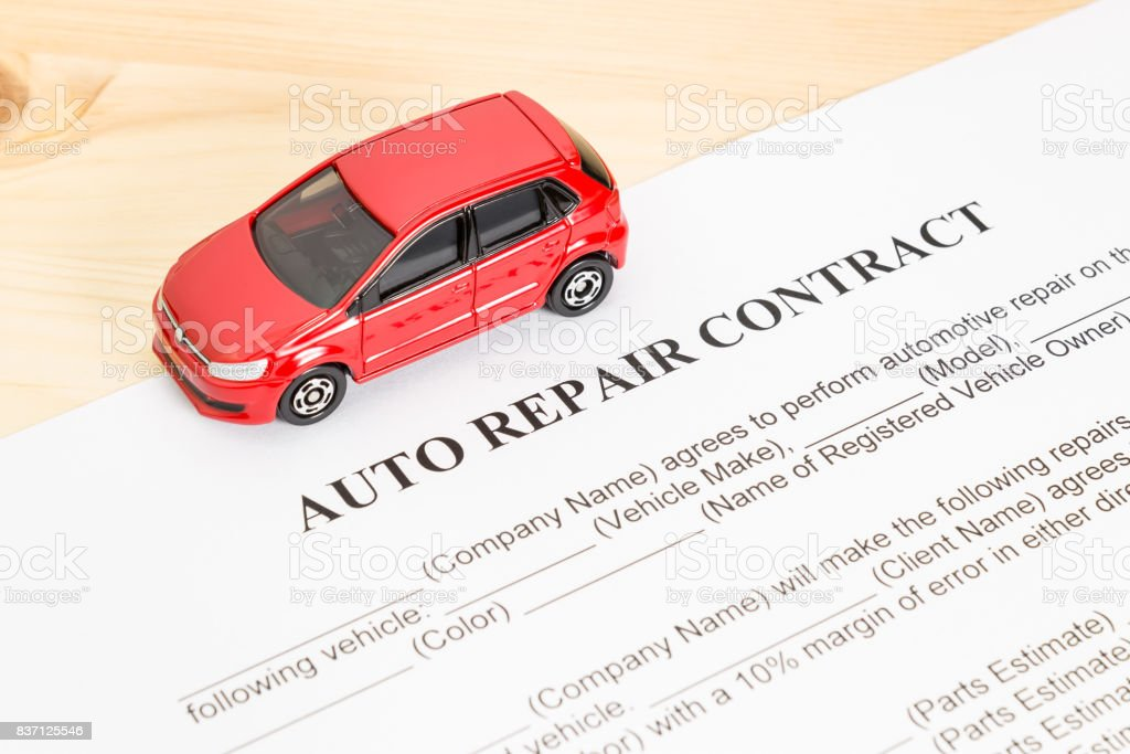Auto Repair Contract With Red Car on Left View stock photo