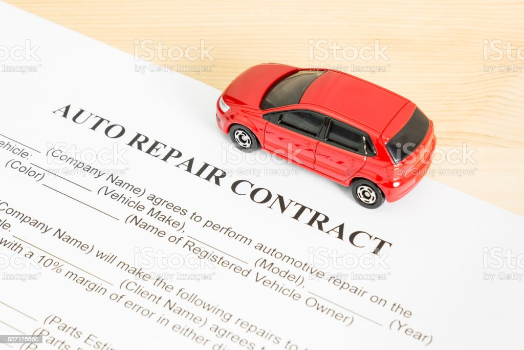 Auto Repair Contract With Red Car on Right View stock photo