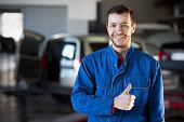 istock Auto repair service. Handsome smiling mechanic 511870078