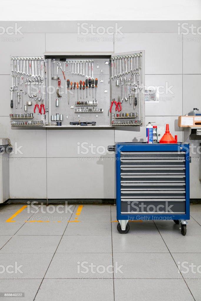 Auto Repair Shop Interior with Mechanic stock photo