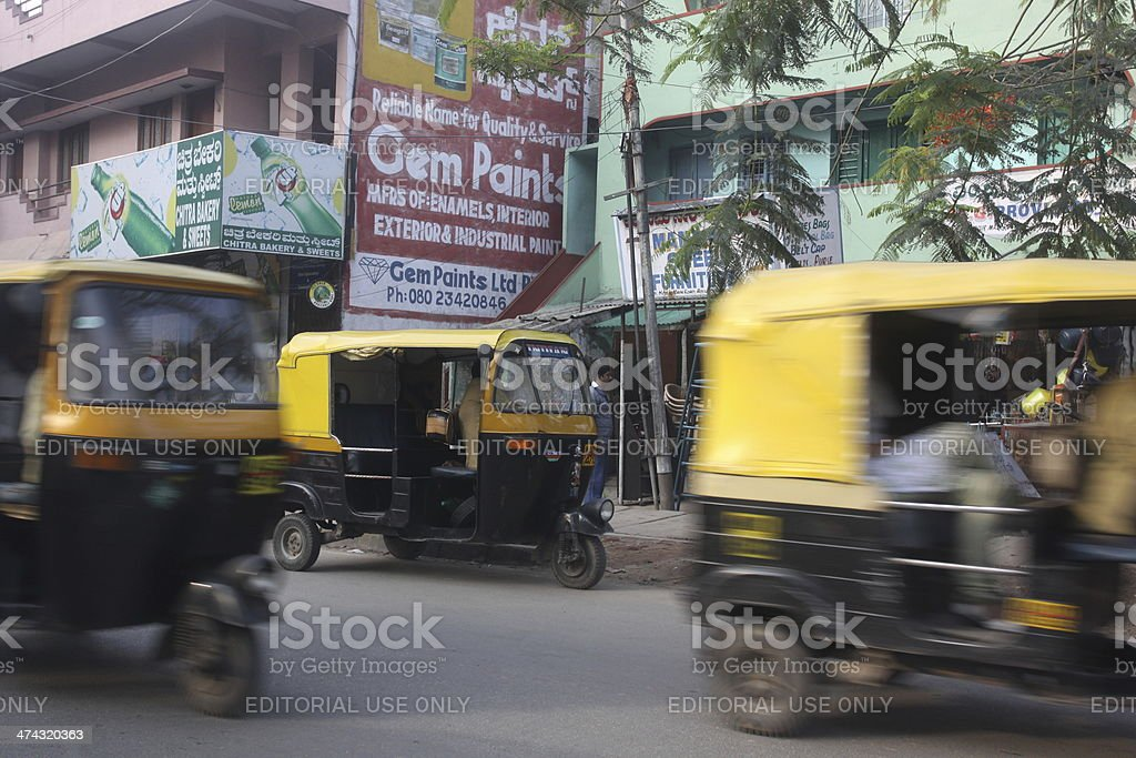 Auto rickshaw on Hosur Road in Bangalore, India royalty-free stock photo