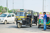 auto rickshaw with vendor at road