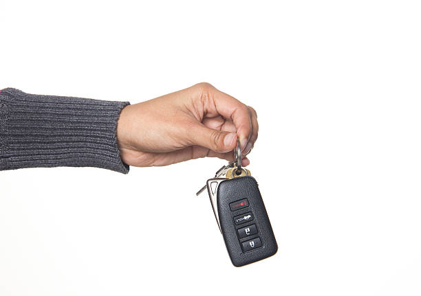 Auto sales - person giving a car key stock photo