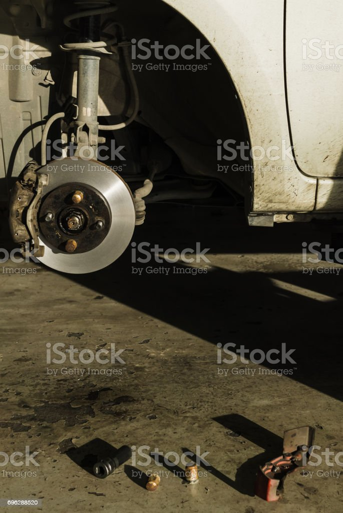 Auto Service, car disc brakes changing stock photo