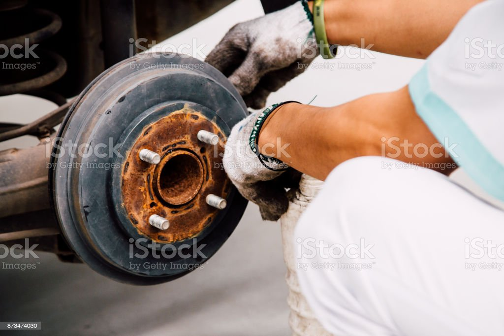 Auto Service. Car mechanic worker replacing brake fluid. stock photo