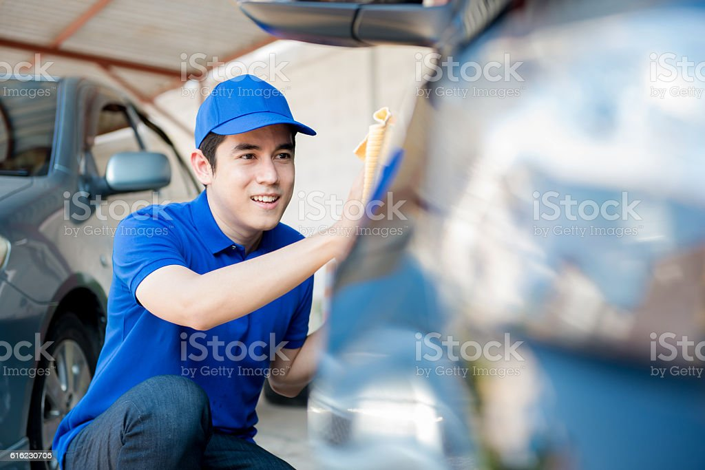 Auto service staff cleaning car stock photo