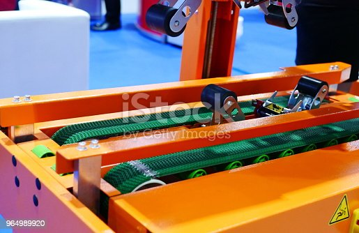 istock Auto taping machine for packing process 964989920