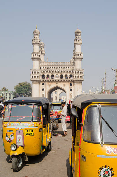 Auto Taxis at Hyderabad's Charminar Hyderabad, India - January 10, 2013: Auto taxis waiting for passengers by the landmark Charminar tower. char minar stock pictures, royalty-free photos & images