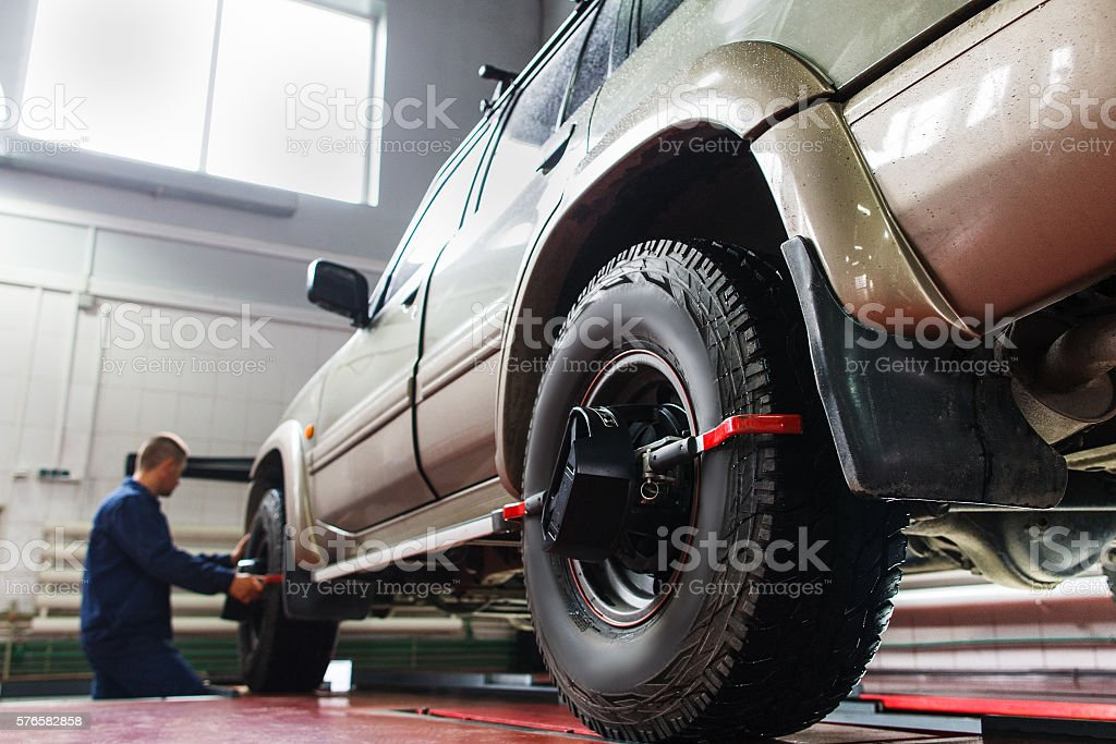 Auto wheel alignment in garage ,SUV maintenance stock photo