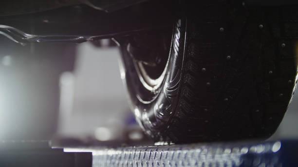 Auto wheel alignment in service, car preparing for professional diagnostics stock photo