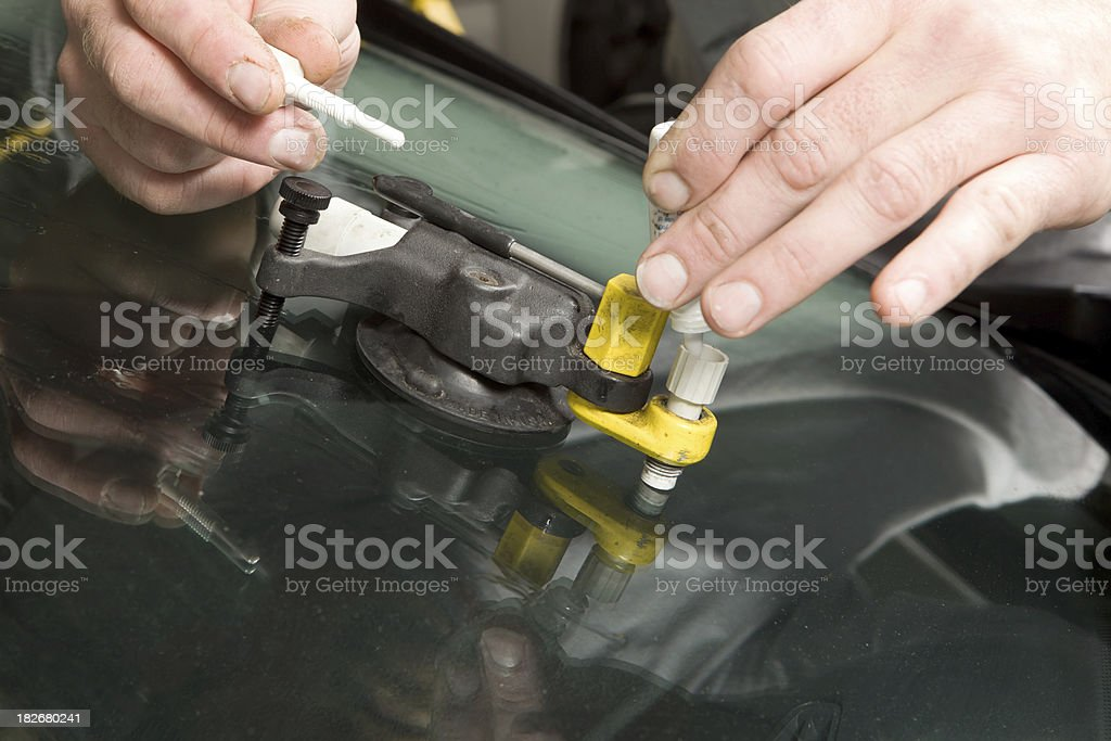 Auto Windshield Rock Chip Repair royalty-free stock photo