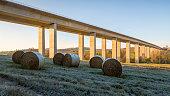 Autobahn bridge and frozen hay bale