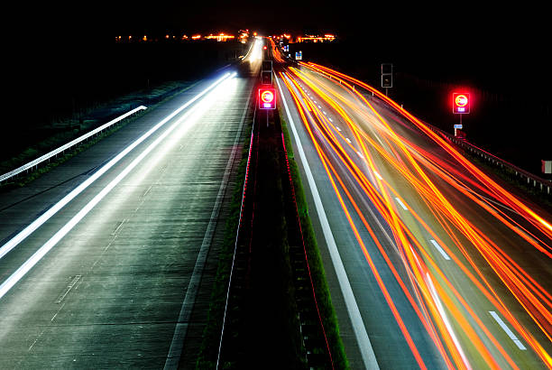 autobahn in germany at night - perpetual motion stock photos and pictures