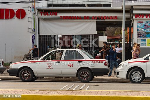 istock ADO Autobus Terminal with tourists and taxis. 1023142948