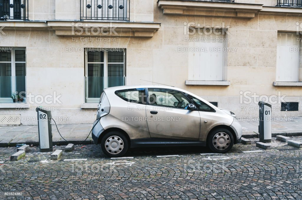 Autolib car parked and charging for rental on the street in Paris stock photo