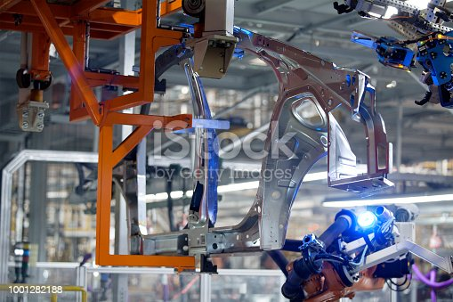989526318 istock photo Automated assembly line automotive welding laser arm is working 1001282188