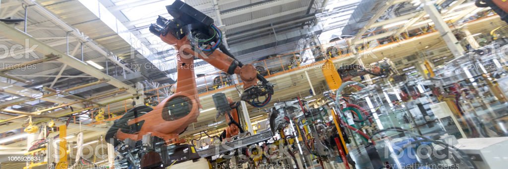 Robotic equipment collects cars on the production line. Long format...