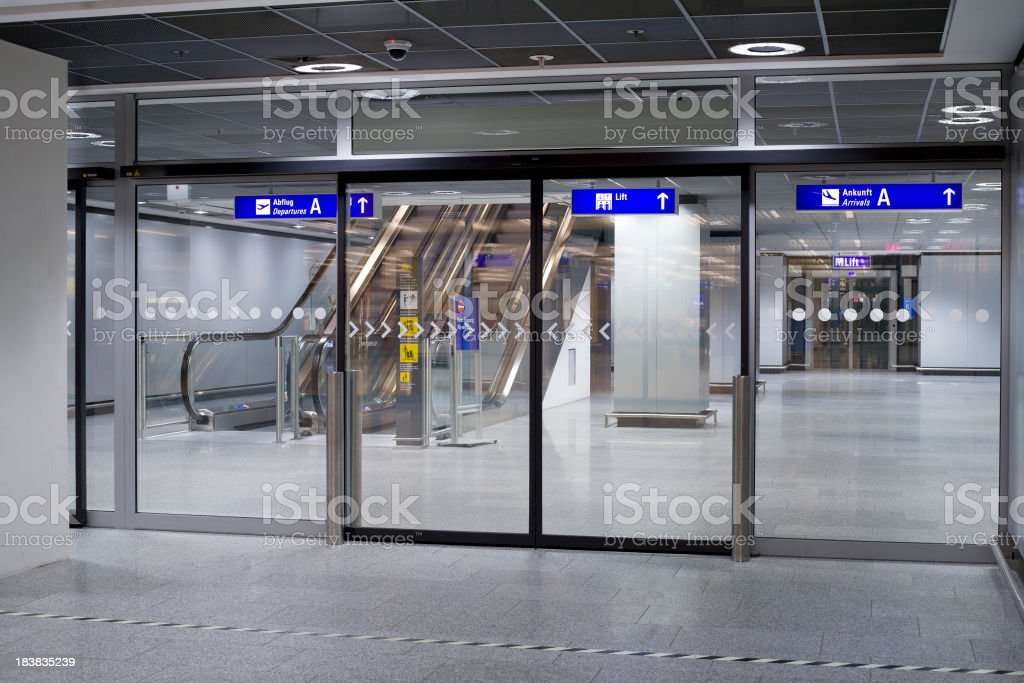 Automated connecting doors and staircase at the airport stock photo