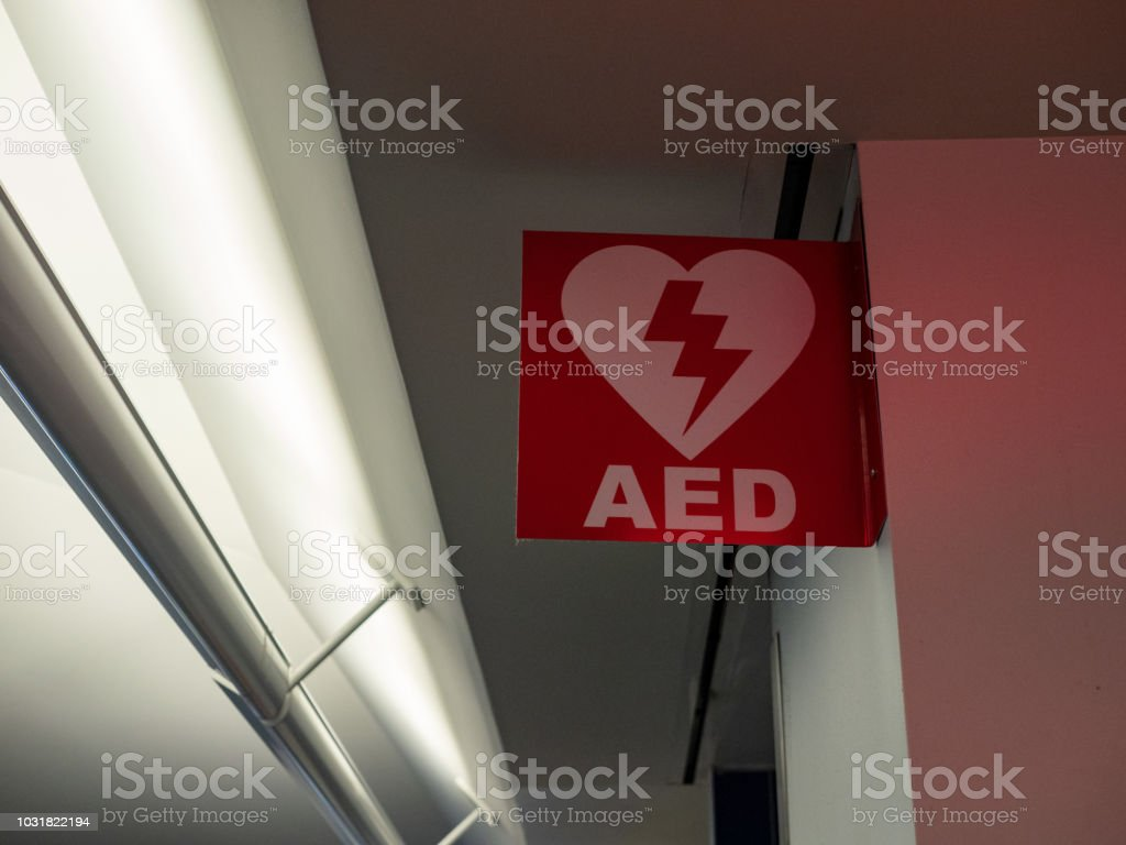 Automated external defibrillator AED logo hanging in public area stock photo