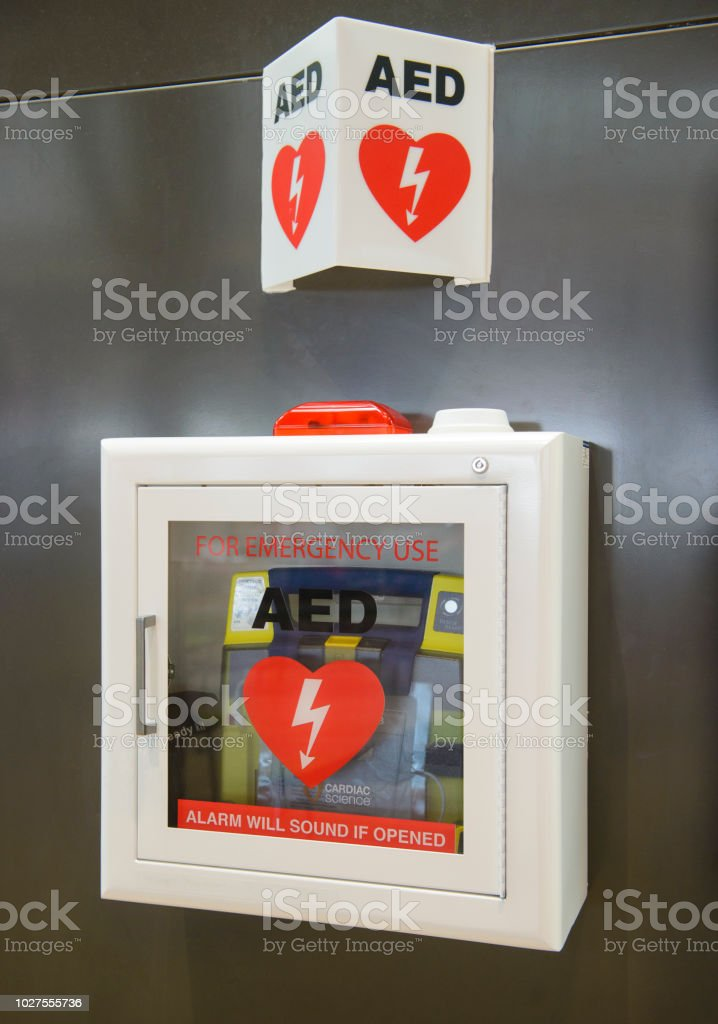 Automated External Defibrillator(AED) on the wall can be found in almost all airport and train stations stock photo