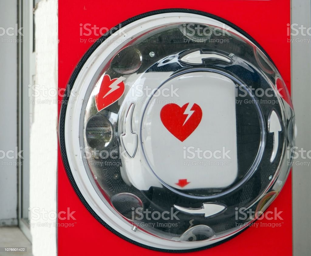 Automated external defibrillator, or AED, with its international symbol hanging in a public place. stock photo