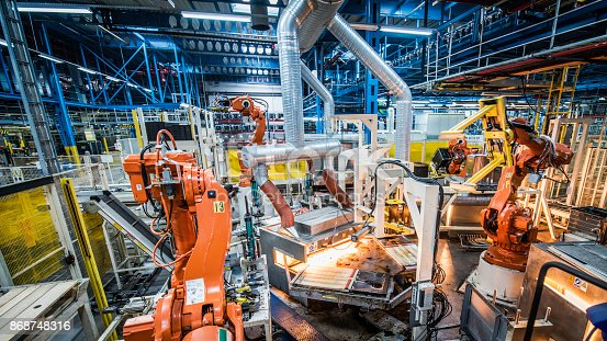 Robotic arms in a household appliances factory.