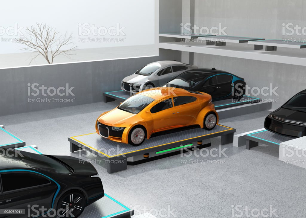 Automated Guided Vehicle (AGV) carrying yellow car to parking space stock photo