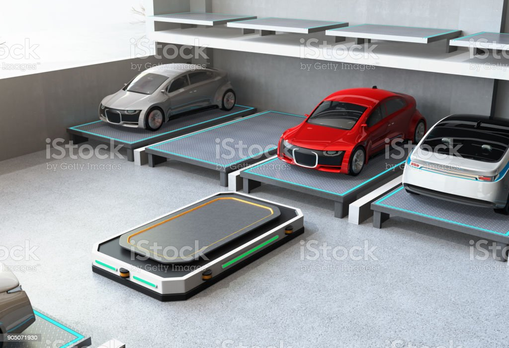 Automated Guided Vehicle (AGV) leaving the parking space to picking next car stock photo