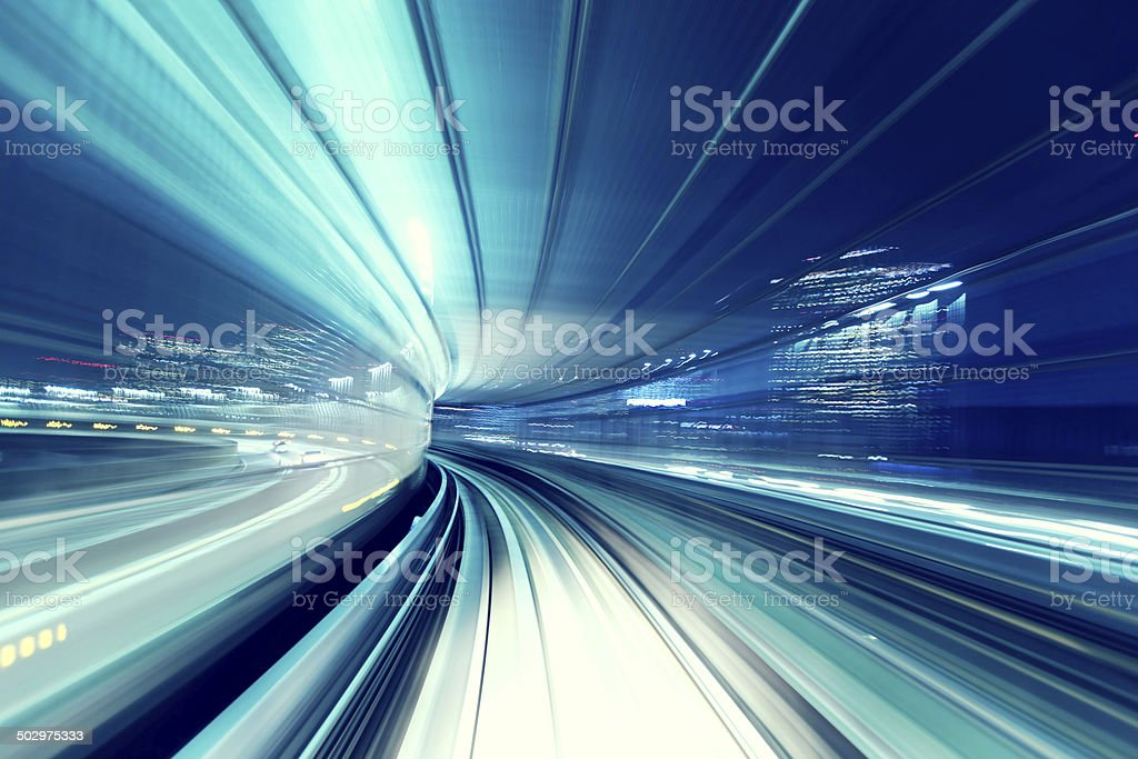 Automated guide-way train at night stock photo