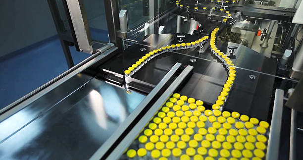 Automated line for marshalling bottles of drugs. stock photo