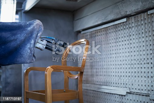 Modern Automated Robot Arm Spraying With Lacquer On Wooden Chair In Furniture Manufacturing.