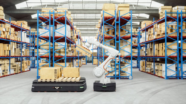 Automated Robot Carriers And Robotic Arm In Modern Distribution Warehouse stock photo