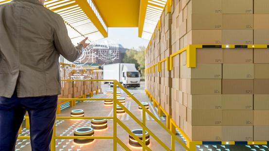 istock Automated robot carriers in modern distribution warehouse 1054014482