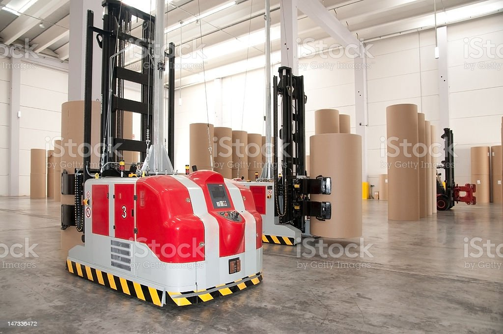 Automated warehouse (paper) with robotic forklift stock photo