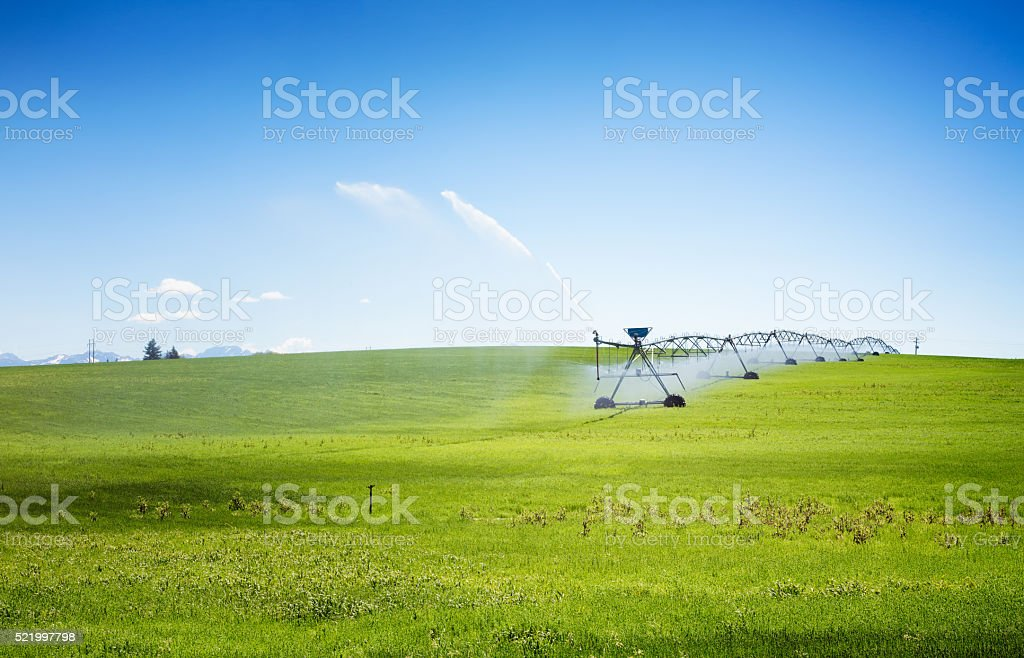Automated wheeled irrigation system stock photo