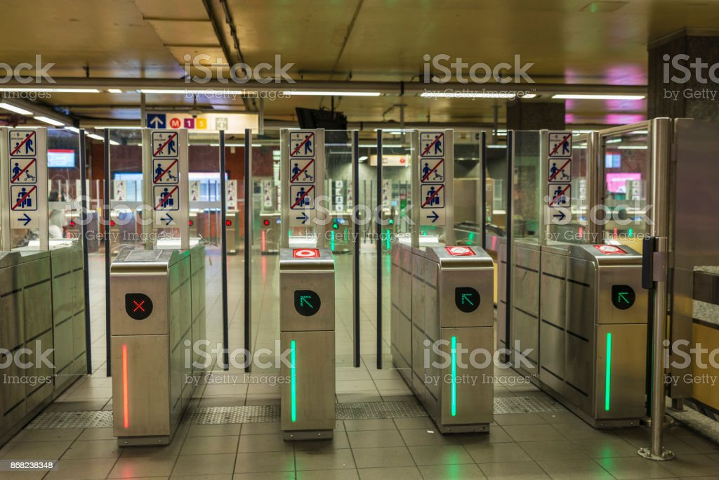 Automatic access control ticket barriers in subway station stock photo