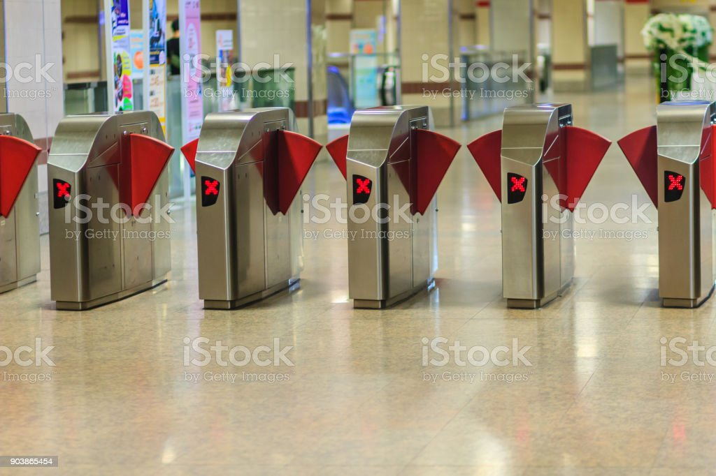 Automatic access control ticket barriers in subway station. View of barrier gate before access in to subway station. Automatic ticket barriers at subway entrance. stock photo